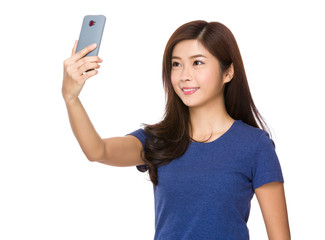 Young woman take selfie on mobile phone