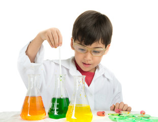Little boy learning in chemecal in science in class