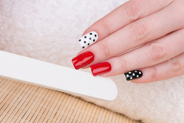 Manicure - nail art with polka dots.