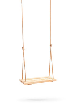 Wwooden swing hanging on a couple of ropes