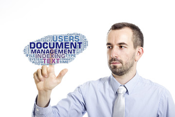 """Young buinessman touching """"Document Management"""" word cloud"""