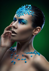 woman in blue stones