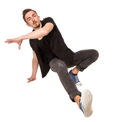 Break dancer doing one handed handstand against a white