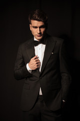 Attractive young business man looking at the camera