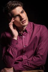 Young fashion man thinking
