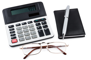 Calculator, notepad, pen and glasses isolated on white