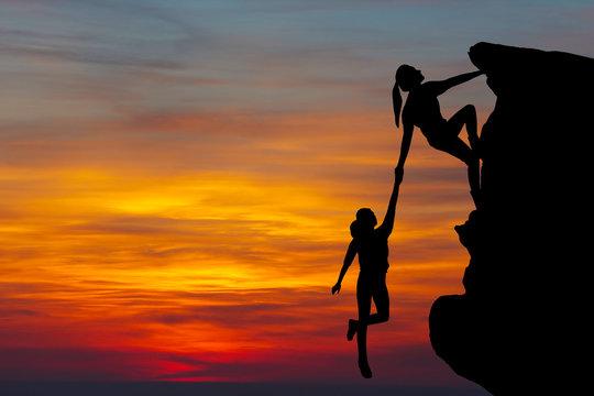 Teamwork couple hiking help each other trust
