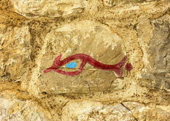 Stylized picture of fish - symbol of Christianity in old citadel