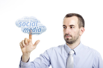 """Young businessman touching """"Social media"""" word cloud"""