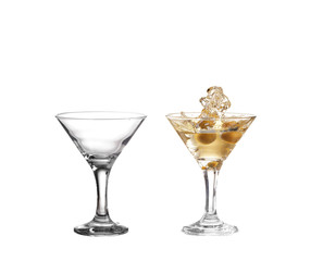 Splash from olive in a glass of cocktail, isolated on the white