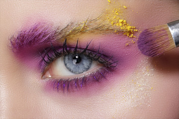 Foto auf Acrylglas Beauty Close up on eyes , making colorful eyeshadows and eyeliner