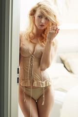 Blond cutie wearing a sexy corset