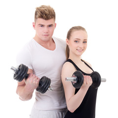 portrait of man and woman in sportswear with dumbbells isolated
