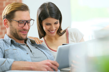 Couple at home shopping on internet