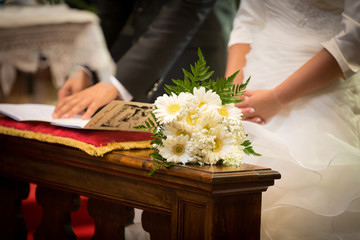 Bride, Groom and Bouquet in a Wedding Day