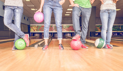 scene with four people and bowling balls