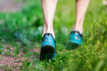 Closeup of running shoes of woman barefoot.