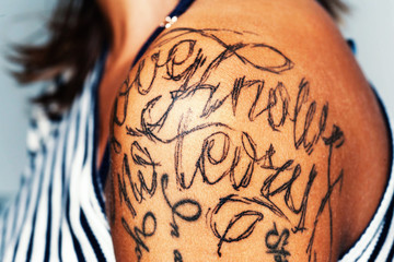Image of tattooed female shoulder. Tattoo. Close-up portrait of