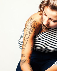 Tattoo. Close-up portrait of a Young girl wearing stripped t-shi