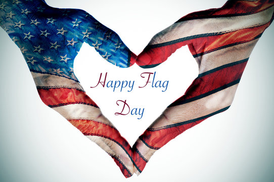 hands forming a heart patterned as the flag of the United States