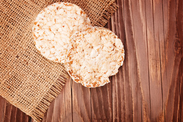 Round rice cakes on wooden table
