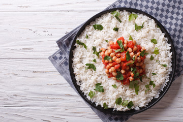 Rice and chickpeas in a tomato sauce horizontal top view