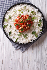 Rice with chickpea on the plate. vertical top view