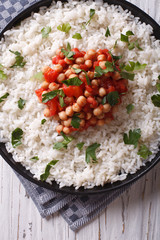 Rice with chickpea and parsley close-up. vertical top view