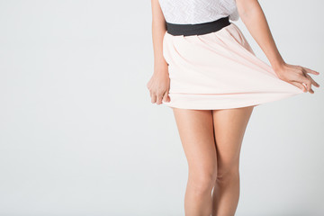 Women's legs in a skirt
