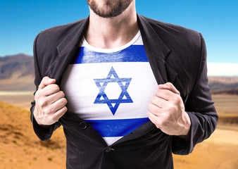 Businessman stretching suit with Israel on desert