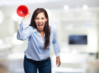 angry woman holding a plunger