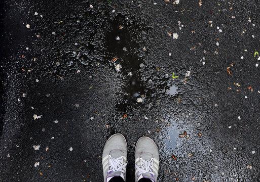 sneakers on wet asphalt
