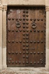 Ancient forged door of historic Toledo house, Spain