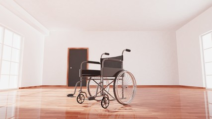 Black disability wheelchair inside empty room with wooden floor