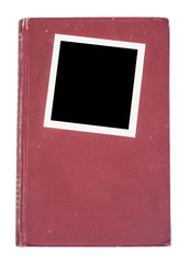 Red hardcover book and photo frame