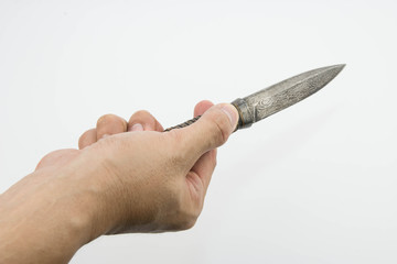 A hand holding a Thai knife isolated on white background