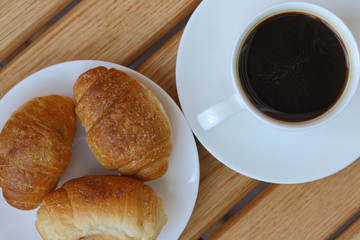 aromatic coffee and croissants on a plate