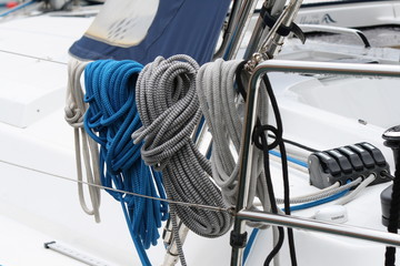 white gray and blue ropes on the deck of a sailboat, italy, loano harbor
