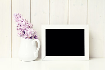 flower in white vase greeting card background with blackboard