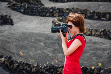 woman with pfoto camera