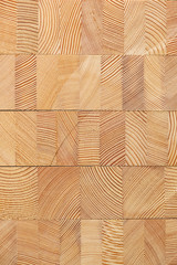 Background with glued larch wooden blocks.