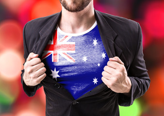 Businessman stretching suit with Australia Flag on bokeh