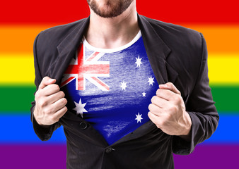 Businessman stretching suit with Australia Flag with rainbow