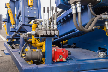 Hydraulic tubes, fittings and levers on control panel of  mechan