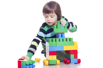 Little boy playing lego