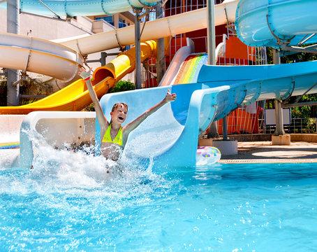 Child in bikini sliding water park.
