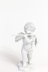 Angel playing the flute figure figurine isolated on a white background