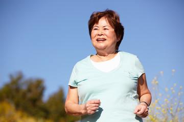Senior woman jogging