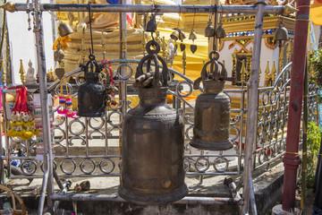 Large bronze buddhist bell at Phra Borommathat temple Tak Province ,Thailand.