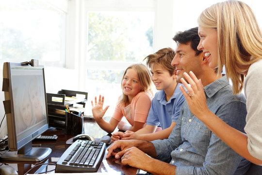 Family using skype in home office